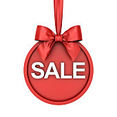 istock Christmas sale round banner hanging with red ribbon and bow isolated over white background 895791684