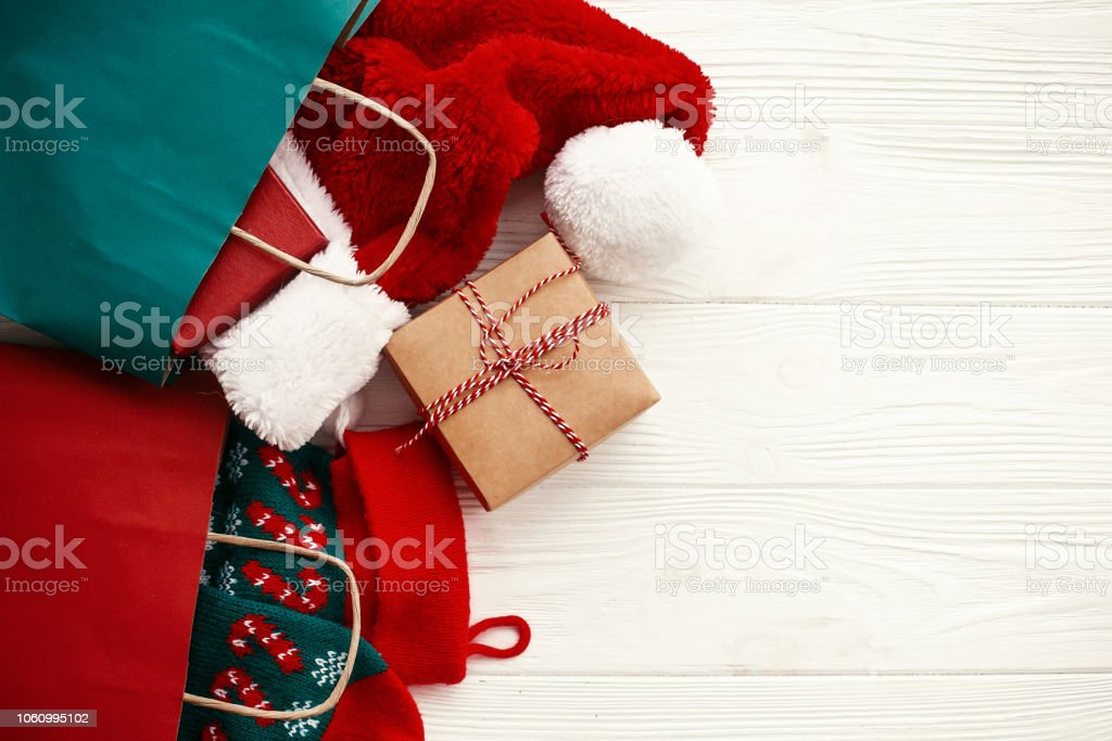 Christmas Sales And Shopping Concept Paper Bags With Clothes Stockings Gift Box On White Rustic Background Top View Space For Text Big Sale Advertisingbags With Stuff And Presents Stock Photo Download,Country Cottage Decor Uk