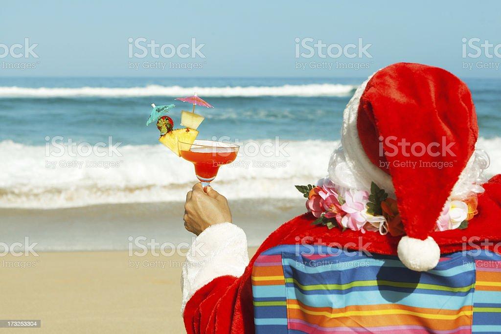 Christmas Santa Claus Enjoying Tropical Beach Vacation Holiday Travel stock photo