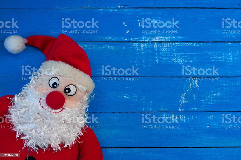 Christmas Santa Claus on a blue wooden background zbiór zdjęć royalty-free