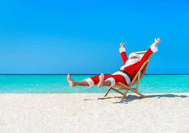 Best Santa Beach Stock Photos, Pictures & Royalty-Free ...