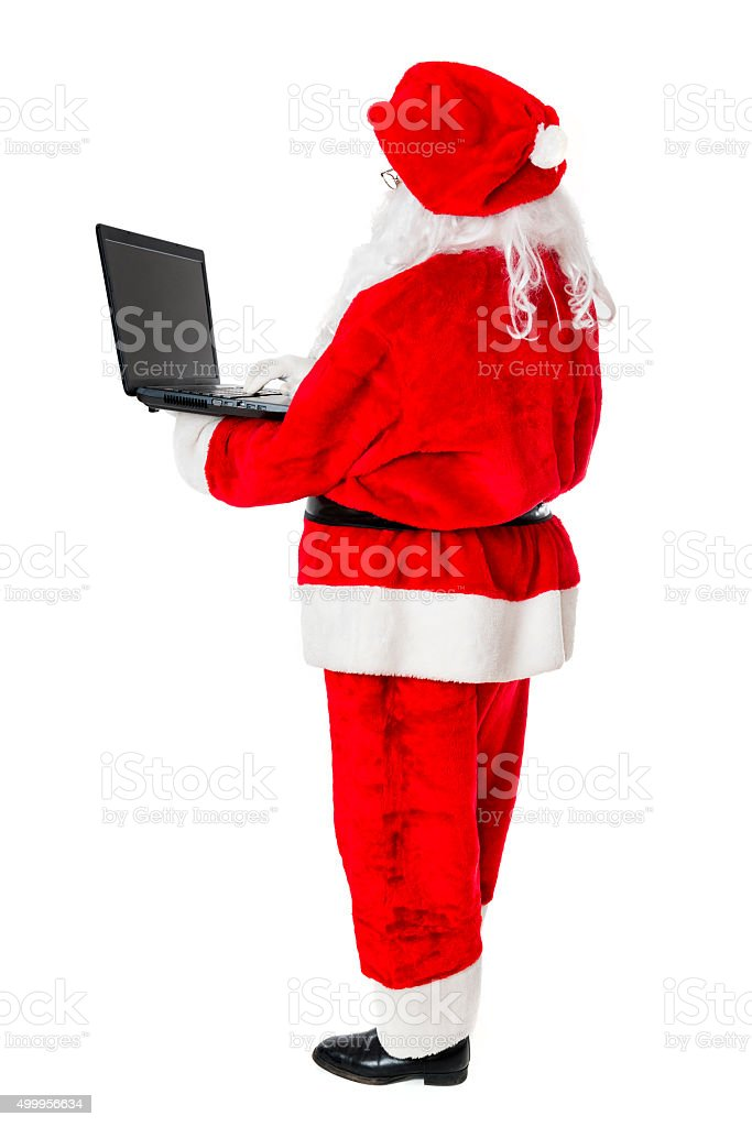 Christmas Santa Claus using Laptop and Surfing for Gifts stock photo