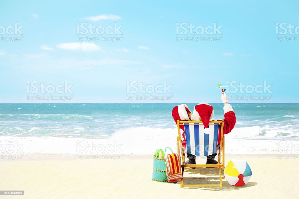 Christmas Santa Claus Vacation in Tropical Beach Paradise stock photo