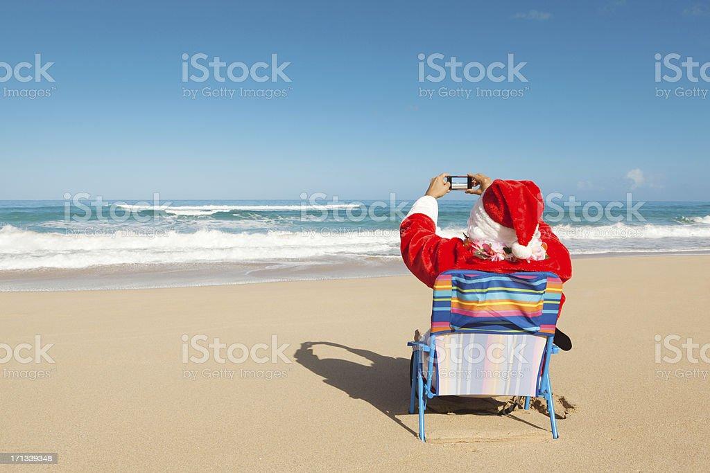 Christmas Santa Claus Vacationing in Tropical Paradise Beach Hz stock photo