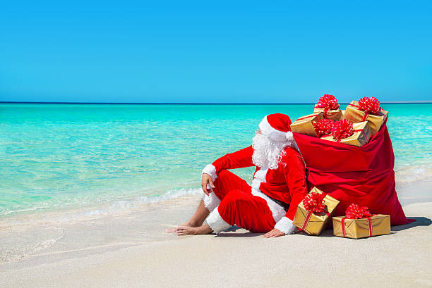 Christmas santa claus with wrapped gift boxes sack at beach picture id499694252?b=1&k=6&m=499694252&s=612x612&w=0&h=igm 2h9gamuw a2 j5a8ucz8p9nl5mpsrypsahxkzpq=