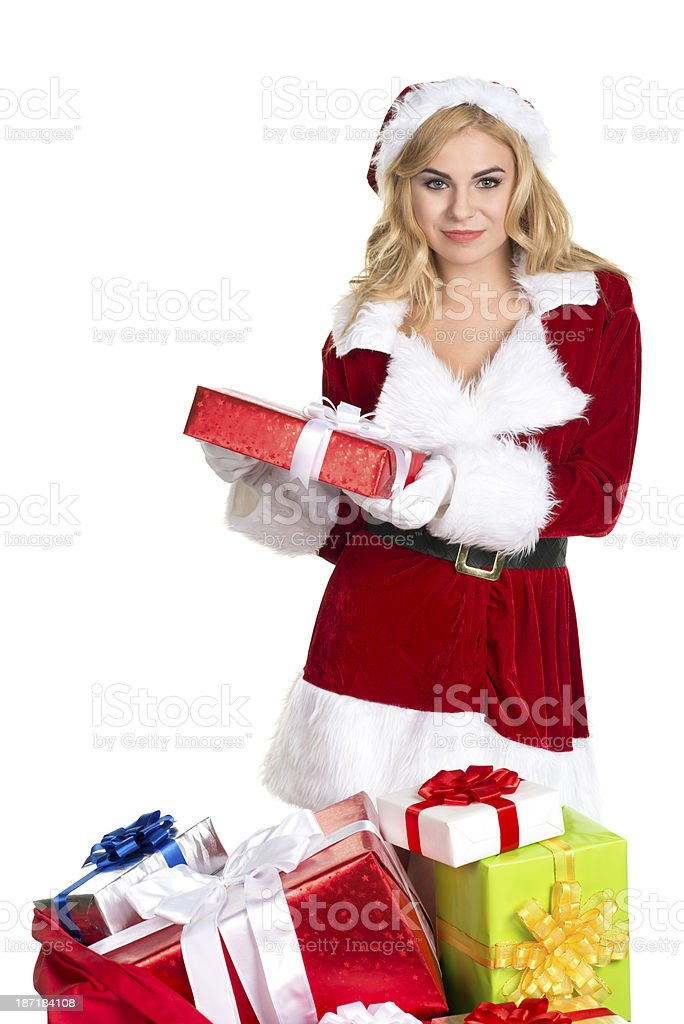 Christmas santa woman holding red gift stock photo