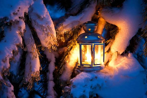 christmas scene - an oil filled lantern burning bright with - kerzenlaterne stock-fotos und bilder