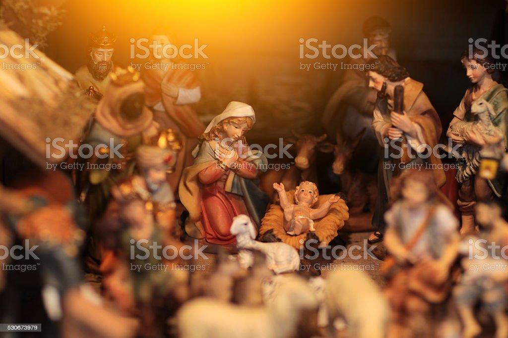 Christmas scene with figurines including Jesus, Mary, Joseph, king stock photo