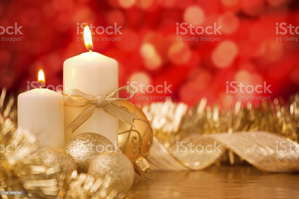 Christmas scene with gold baubles and candles, red background royalty-free stock photo