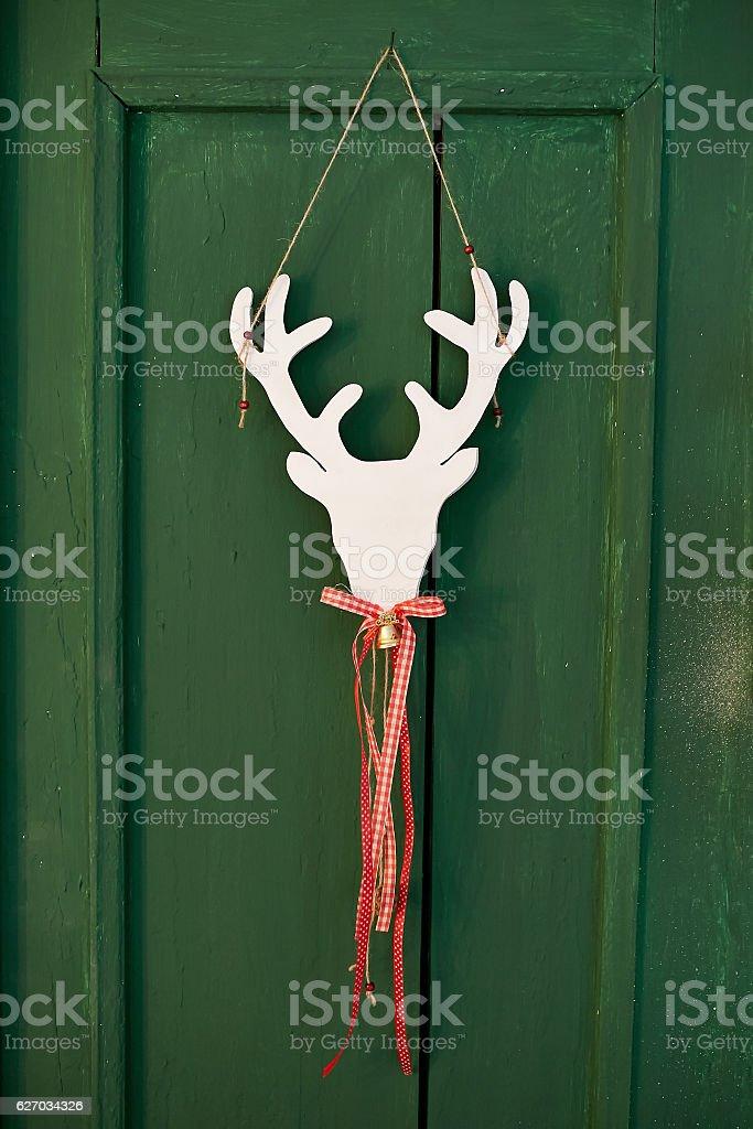 Christmas scenery with deer on the door stock photo