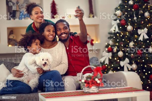 Christmas selfie afro american family making selfie picture id860021694?b=1&k=6&m=860021694&s=612x612&h=fzk3l49hg1x bf3mdl5i6afs1nhhs4wjgfs2idjq8um=
