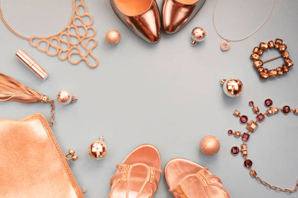 Christmas Set of fashion accessories flat lay shoes handbag necklace jewelry gold color on blue grey background Top view copy space stock photo