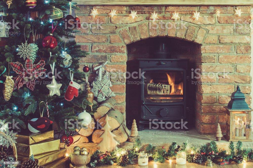 Christmas setting, decorated fireplace, fur tree stock photo