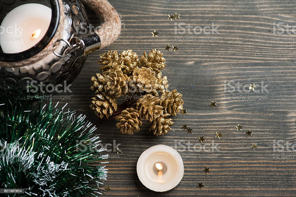 Christmas setting with golden pines, lit candles and stars stock photo