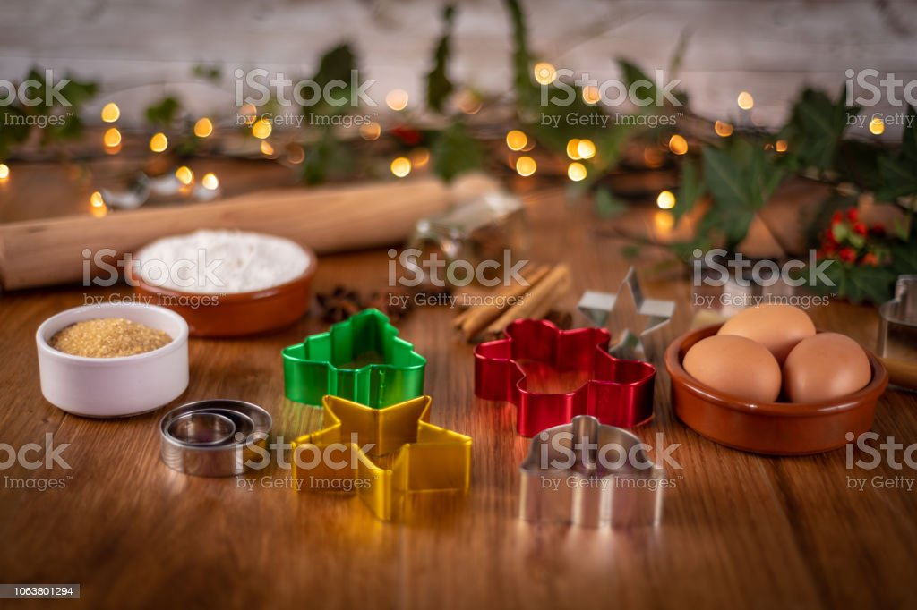 Christmas shaped pastry cutters with cooking ingredients stock photo