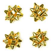 istock Christmas shiny gold present bow isolated. Set of Christmas gift ribbon bow 1185275307