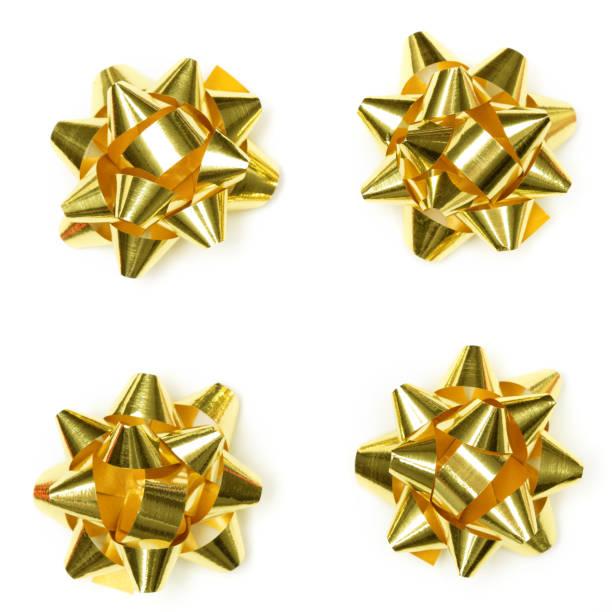 크리스마스 빛나는 골드 선물 활 고립. 크리스마스 기프트 리본 리본 세트 - 머리 리본 뉴스 사진 이미지