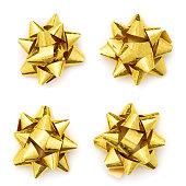 istock Christmas shiny gold present bow isolated. Set of Christmas gift ribbon bow 1185275309