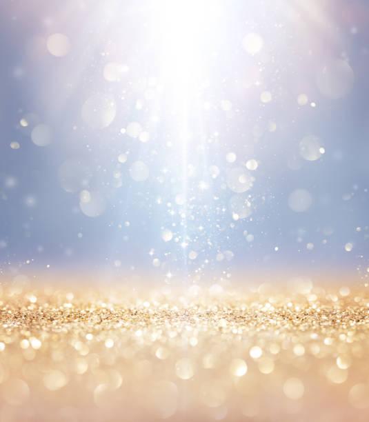 boże narodzenie błyszczące - światła i gwiazdy spadające na złoty brokat - atmosfera wydarzenia zdjęcia i obrazy z banku zdjęć