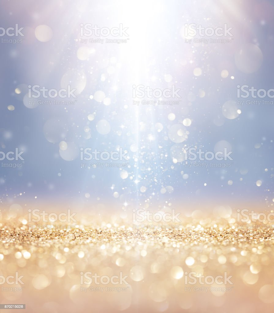 Christmas Shiny - Lights And Stars Falling On Golden Glitter stock photo
