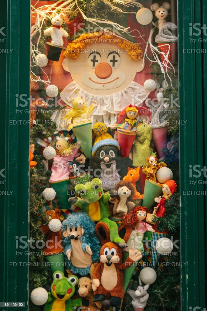 Christmas shop window decorated with soft toys - characters from Czech cartoons stock photo