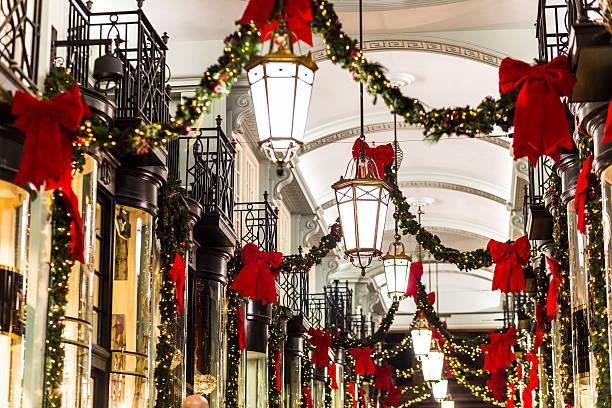 Christmas Shopping Arcade Christmas fairy lights and festive decorations at Burlington Arcade, Bond Street, London. mayfair stock pictures, royalty-free photos & images