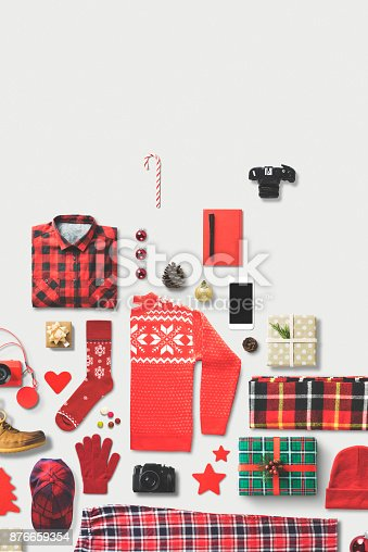 Christmas theme red apparel, ornament, gift box flat lay on white background