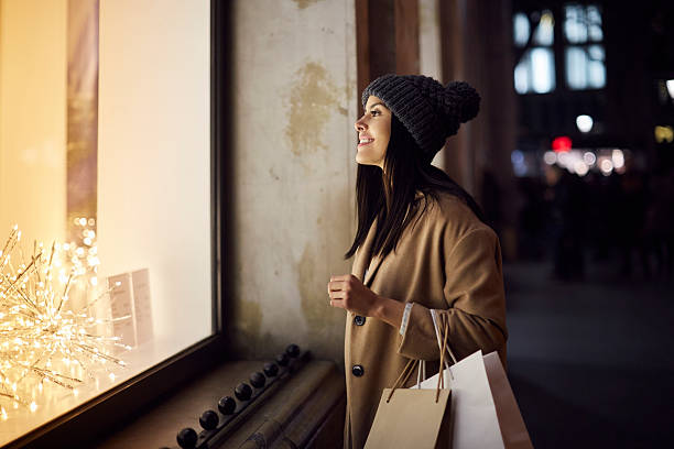 Christmas shopping looking at a window shop. stock photo