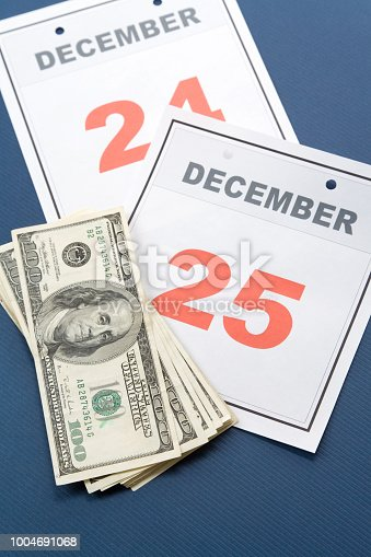 Calendar Christmas day and dollar, concept of holiday shopping