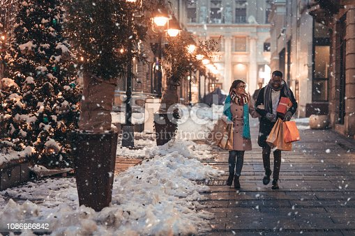 Young couple enjoy shopping Christmas gifts.