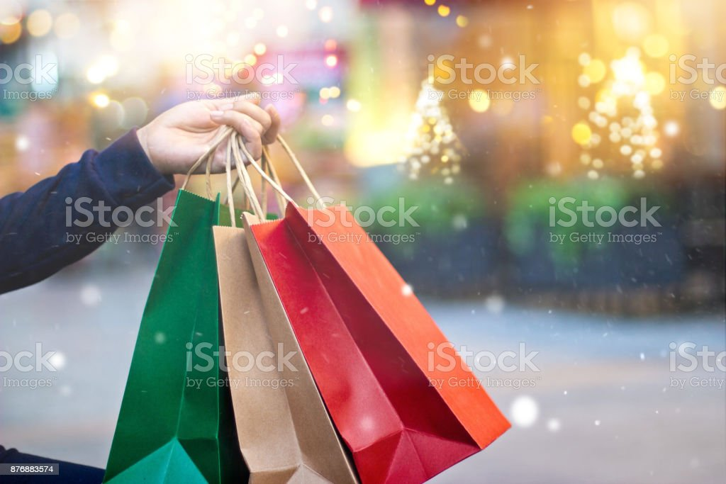 Christmas shopping shopping bags in hand with snowflake on
