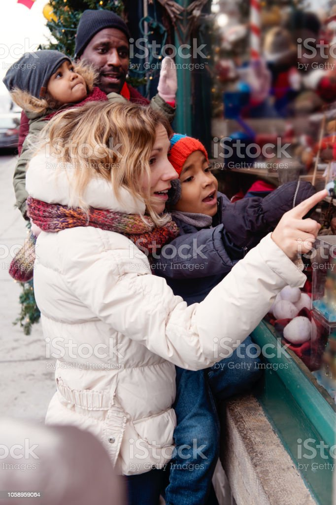 Christmas shopping with a african american dad and a caucasian...