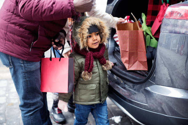 christmas shopping with multi-ethnic family - manonallard stock photos and pictures