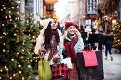 istock Christmas Shopping with two young women 885670498