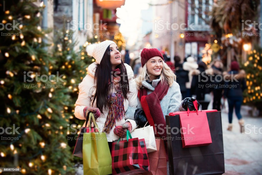 Christmas Shopping with two young women stock photo