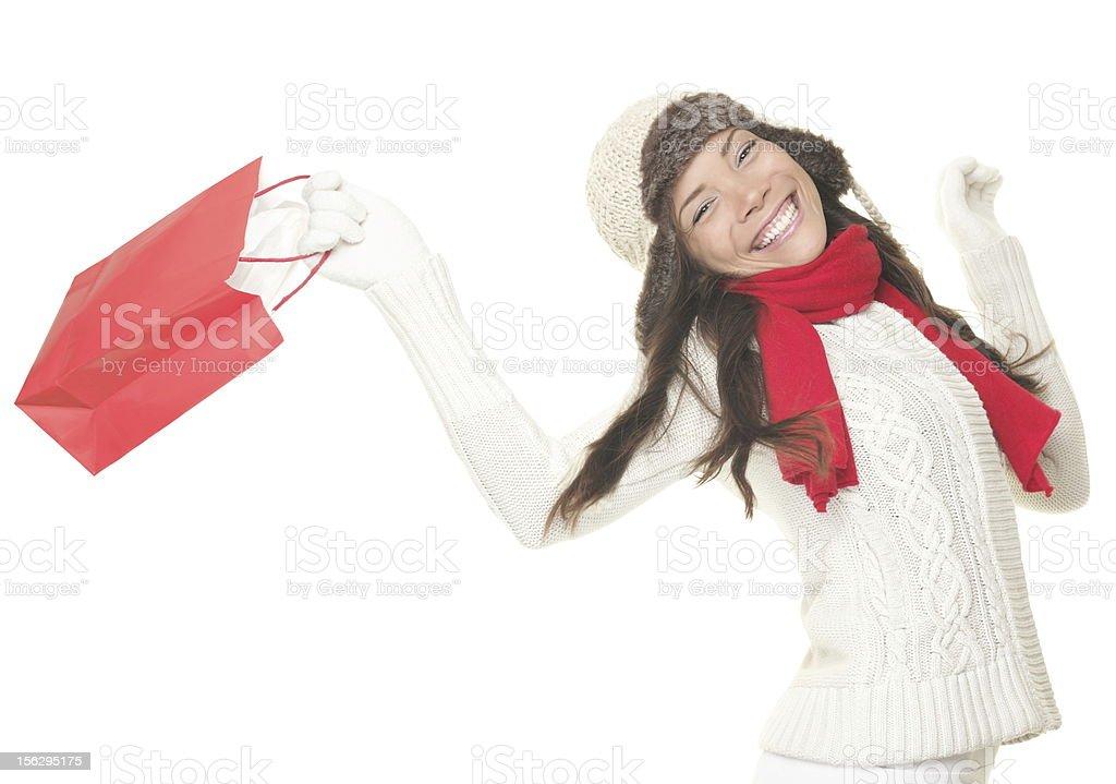 Christmas shopping woman with gift bag royalty-free stock photo