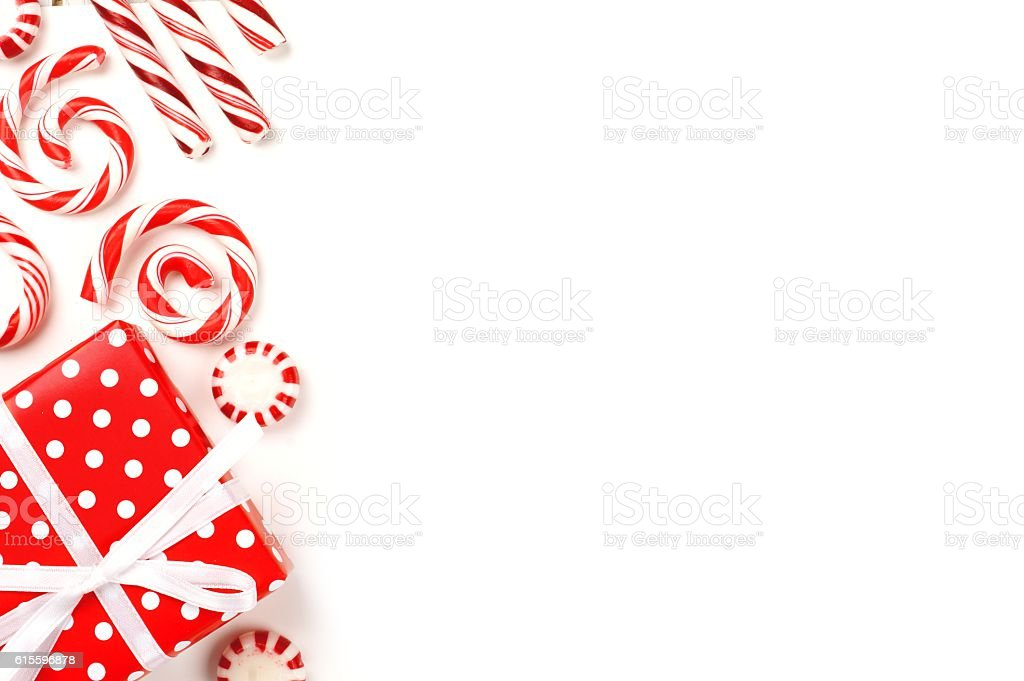 Christmas side border of red and white gifts and candies stock photo