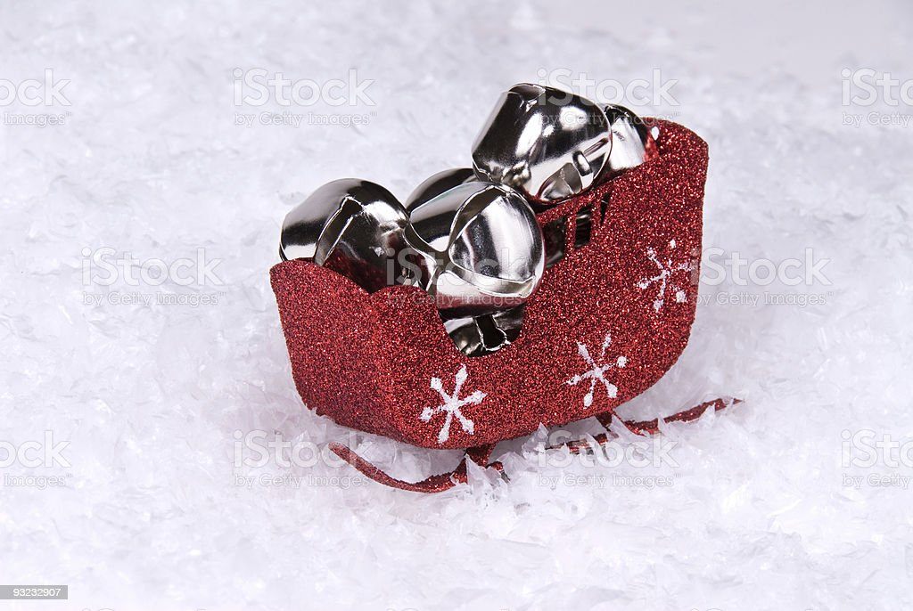 Christmas sleigh carrying silver bells stock photo