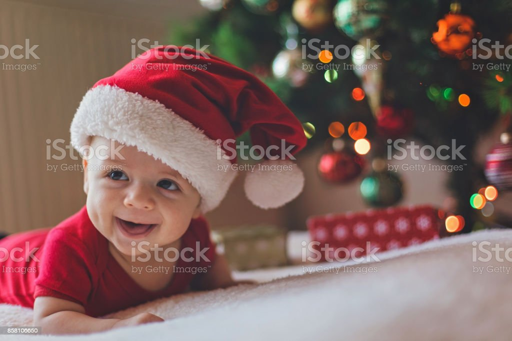 Christmas smiling baby stock photo