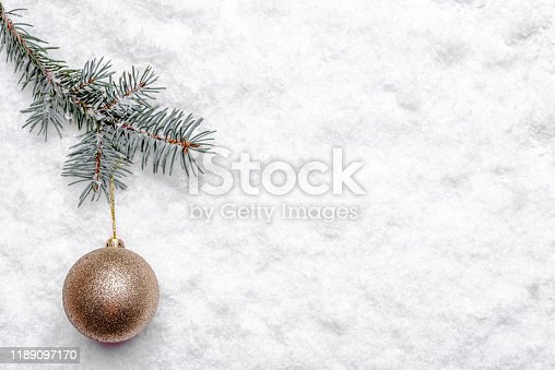 Christmas snow, fir tree branch and ornament, christmas background