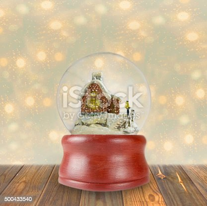 istock Christmas snow globe on wooden background 500433540