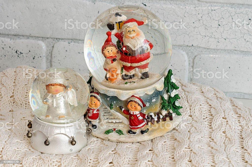 Christmas snow globe with santa claus inside stock photo