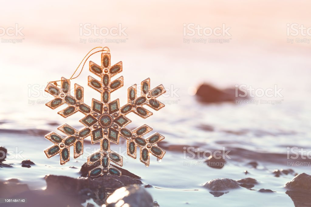 Christmas Snowflake At Sunset On The Beach stock photo
