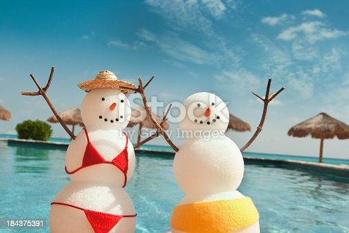 Christmas Snowman Enjoying Winter Beach Vacation Fun By Swimming Pool Stock Photo More Pictures Of Adult