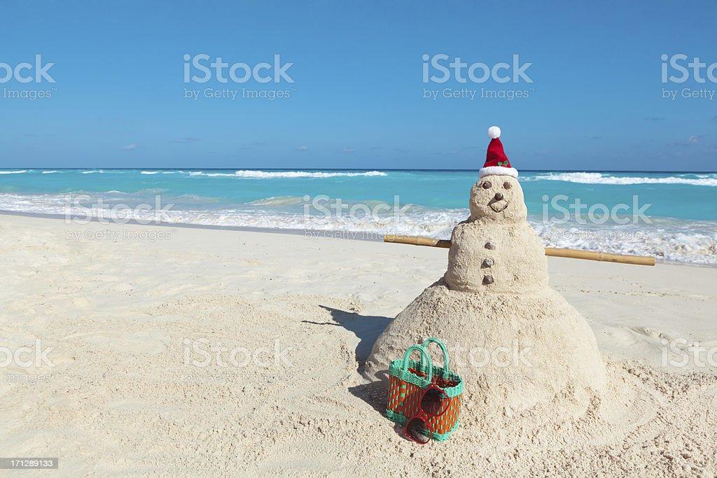 Christmas Snowman Santa Claus Winter Vacation in Tropical Beach Hz stock photo