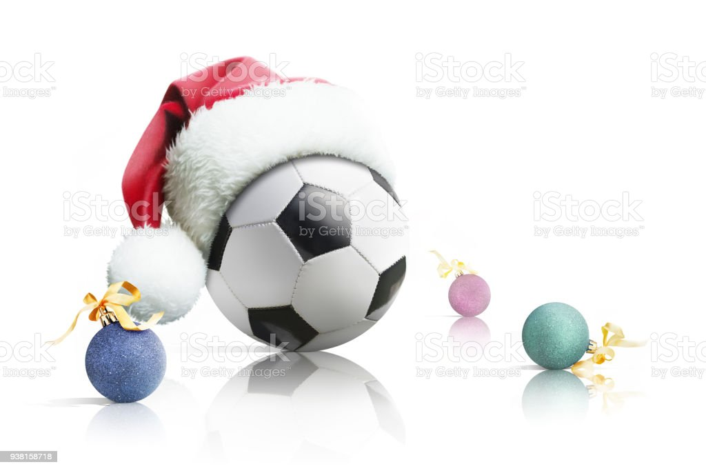 Christmas Sports Background.Christmas Soccer Soccer Ball In Santa Hat Christmas Toys On