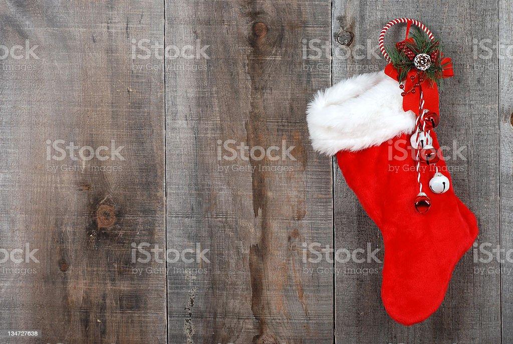 Christmas sock and wreath on wood stock photo