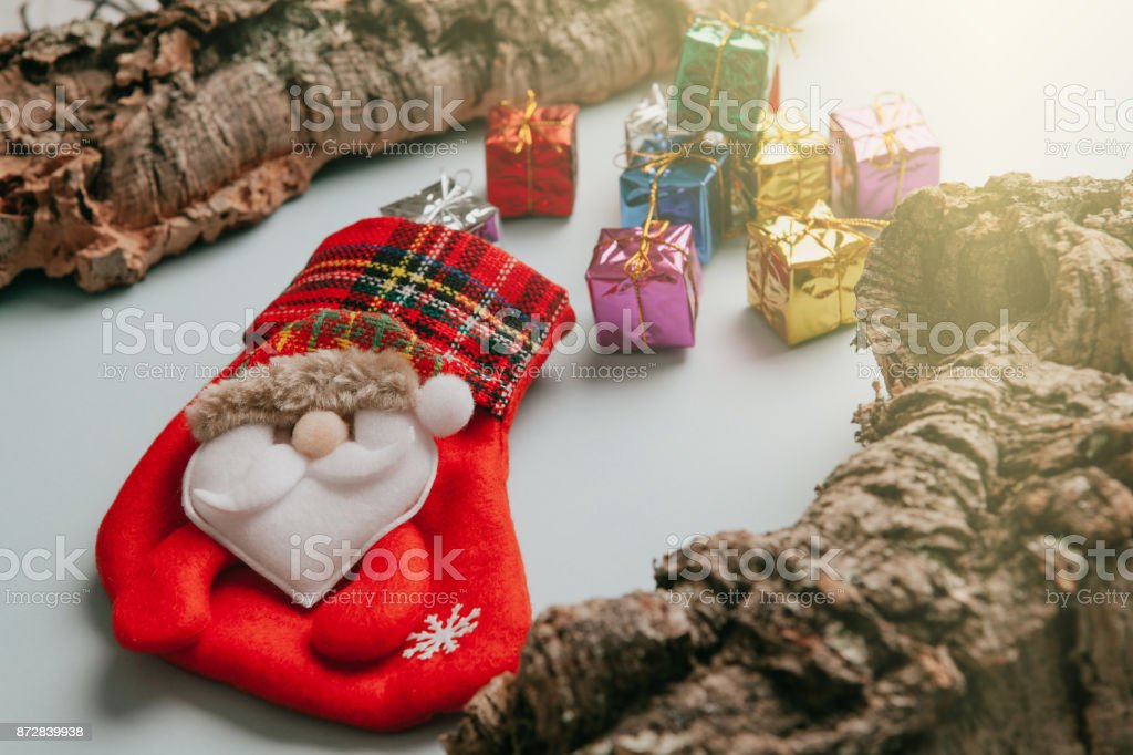 Christmas sock with bunch of gifts getting out from it. stock photo