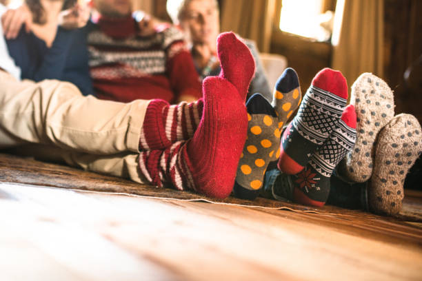 christmas socks at home christmas socks at home cozy stock pictures, royalty-free photos & images