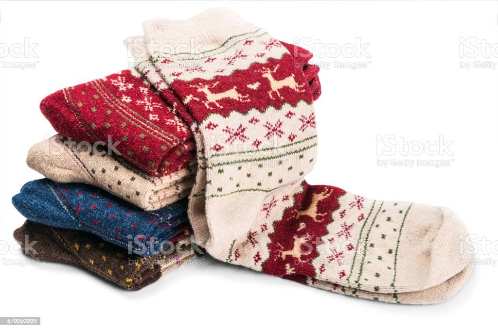 Christmas socks with reindeer and ornaments stock photo